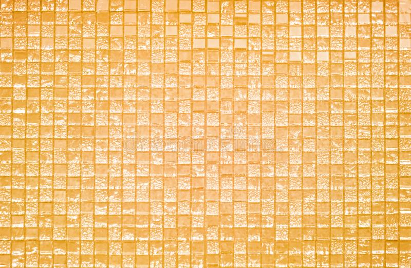 mosaic of yellow glass tiles stock