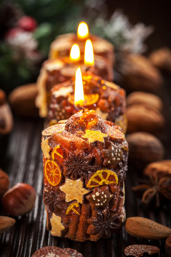Rustic Christmas Candles With Spices And Nuts Royalty Free