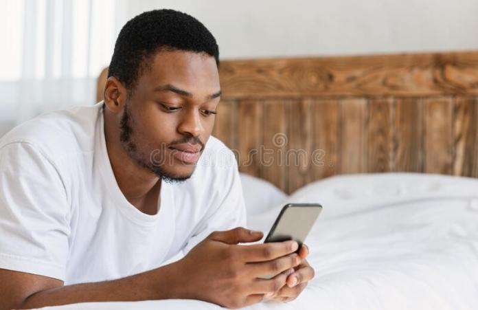 300 Black Man Bed Mobile Phone Photos - Free & Royalty-Free Stock Photos  from Dreamstime