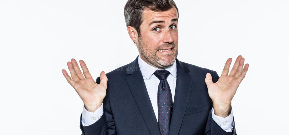 Smiling careless bearded businessman refusing accusation, acting like an hypocrite. Coward or irresponsible for corporate faults, isolated, white background royalty free stock image