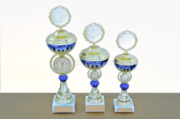 Three Metal Cups Of Gold Color With Blue Details Stock