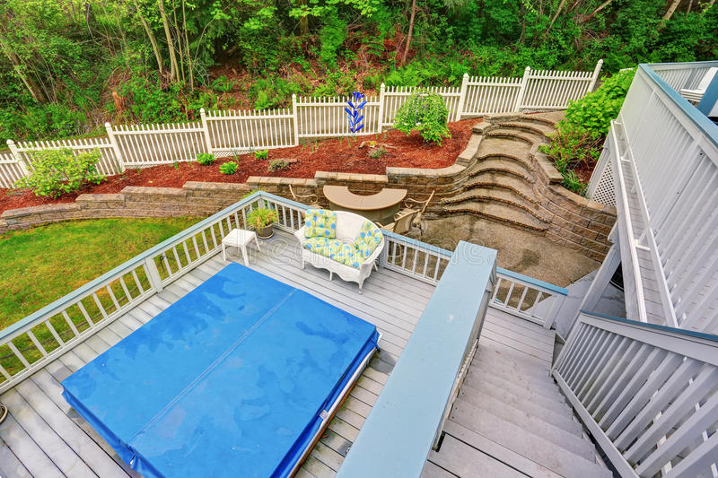 Two Level Backyard Deck With Jacuzzi On The First Floor ... on 2 Level Backyard Ideas id=18594