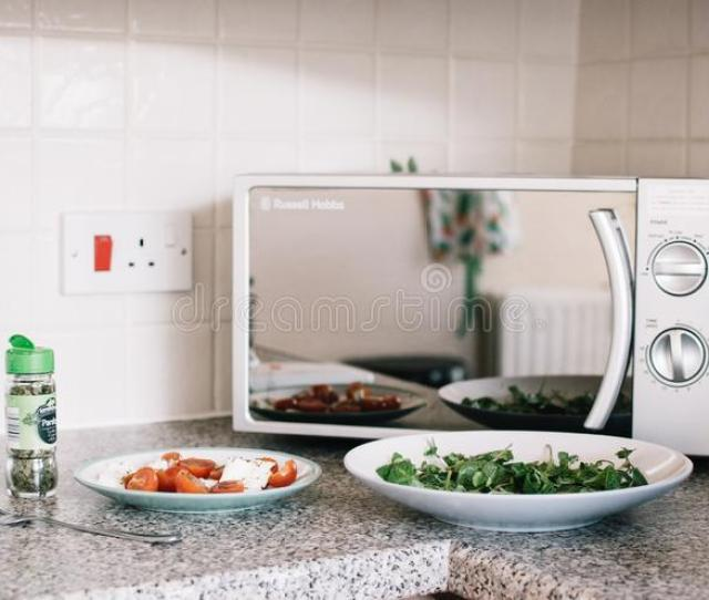Two White Ceramic Plates Near Microwave On Counter Top Free Public Domain Cc Image