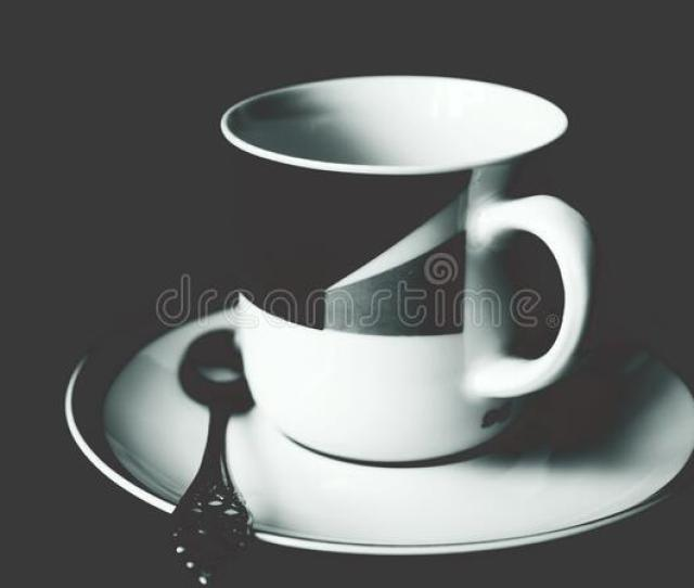 Public Domain Image White And Black Ceramic Tea Mug On White Ceramic Round Plate And Stainless Steel Spoon On Top