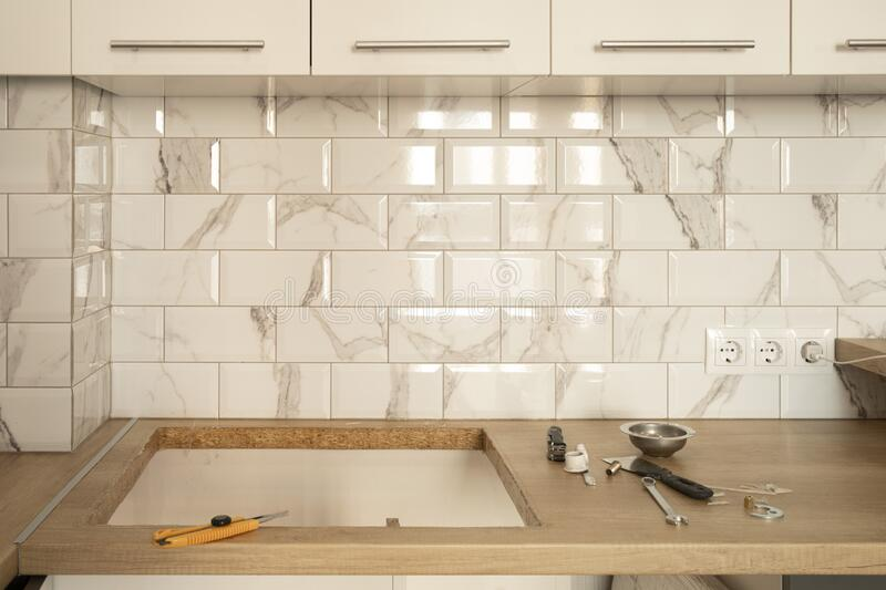 white tile and wooden countertop