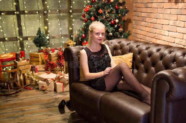 13 Years Old Teen Girl In Dress Resting On Sofa Stock ...