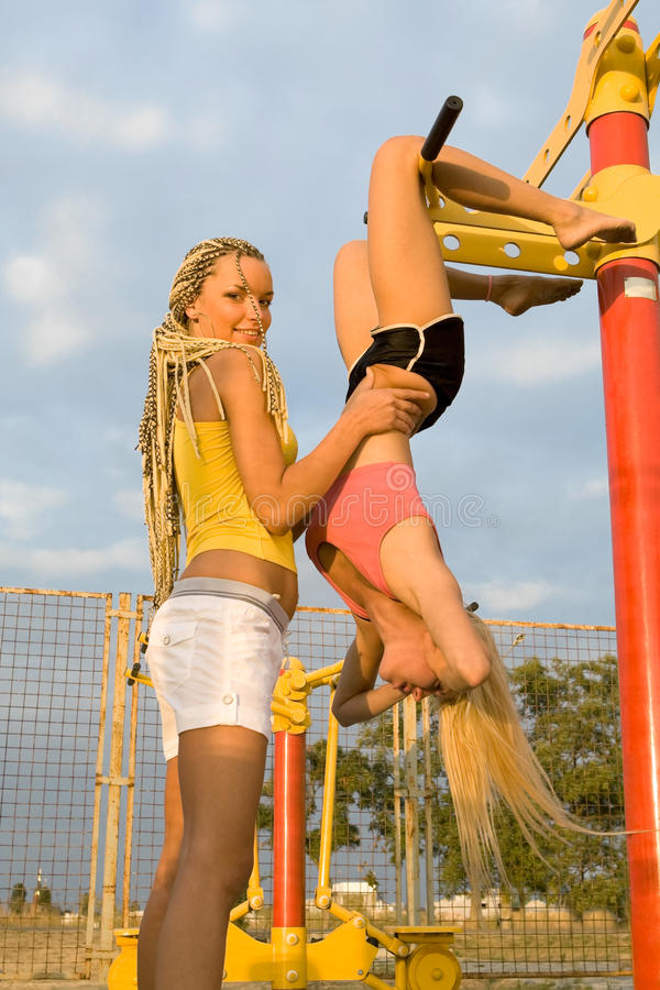 Young Models Working Out On Fitness Playground Stock Photo ...