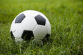 Soccer ball on the green field Royalty Free Stock Photos