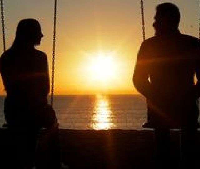 Couple Swinging Looking Each Other At Sunrise Stock Video Footage
