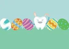 Dente Del Coniglietto Ed Uova Del Giorno Di Pasqua