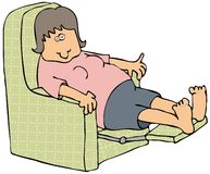 Woman On A Recliner Royalty Free Stock Image