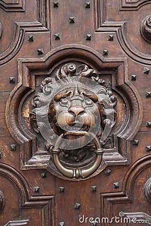 Antique Lion Head Door Knocker On Wooden Door Royalty Free