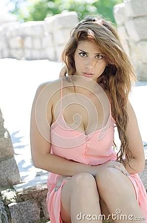 Beautiful Lady In Short Pink Dress Outside Stock Photo