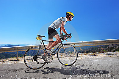Cyclist Riding A Bike Uphill Stock Image Image 16566901