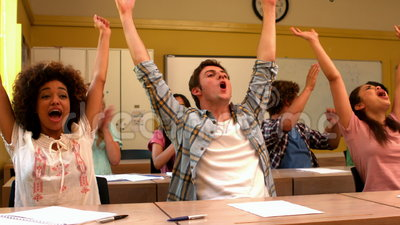 Excited Students Cheering In Classroom Stock Footage ...
