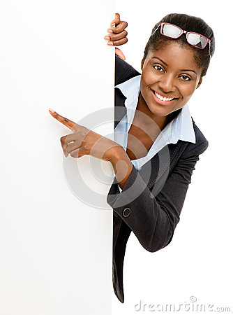 Happy African American Woman Pointing At Billboard Sign