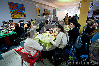 Homeless And Unhealthy People Sit Around Tables With Food