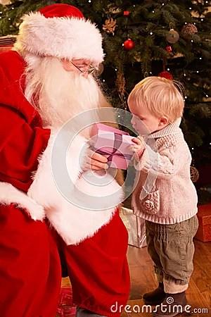 Santa Claus Giving Gift To Boy Stock Photos Image 18917353