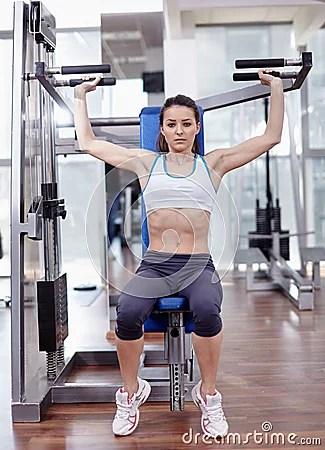 Image result for shoulder press machine woman
