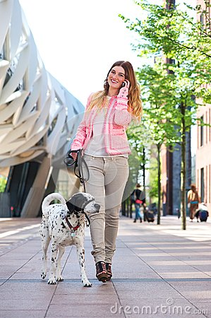 woman walking dog talking to friends mobile phone portrait beautiful young her 31881919