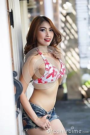 Young Beautiful Asian Woman In Red Bikini With Short Pants