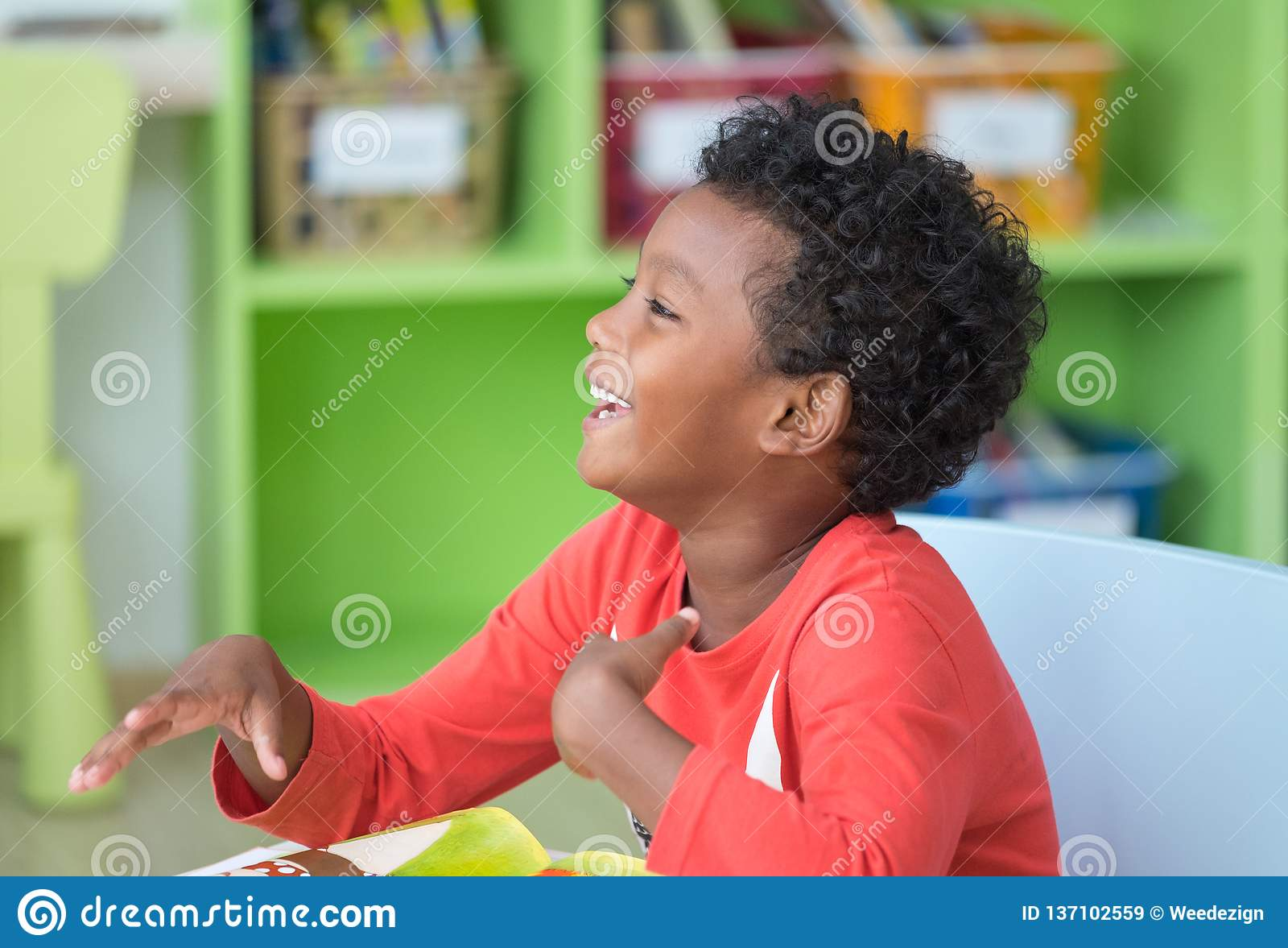 African American Ethnicity Kid Smiling At Library In