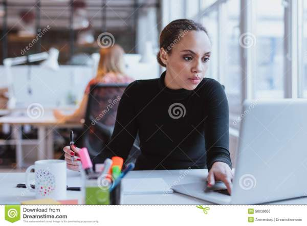African Female Executive At Work Stock Photo - Image of ...