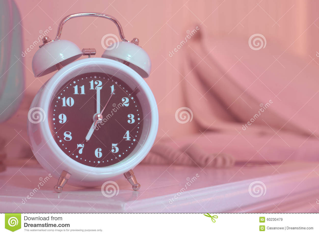 Alarm Clock On The Bed In Bedroom Stock Image