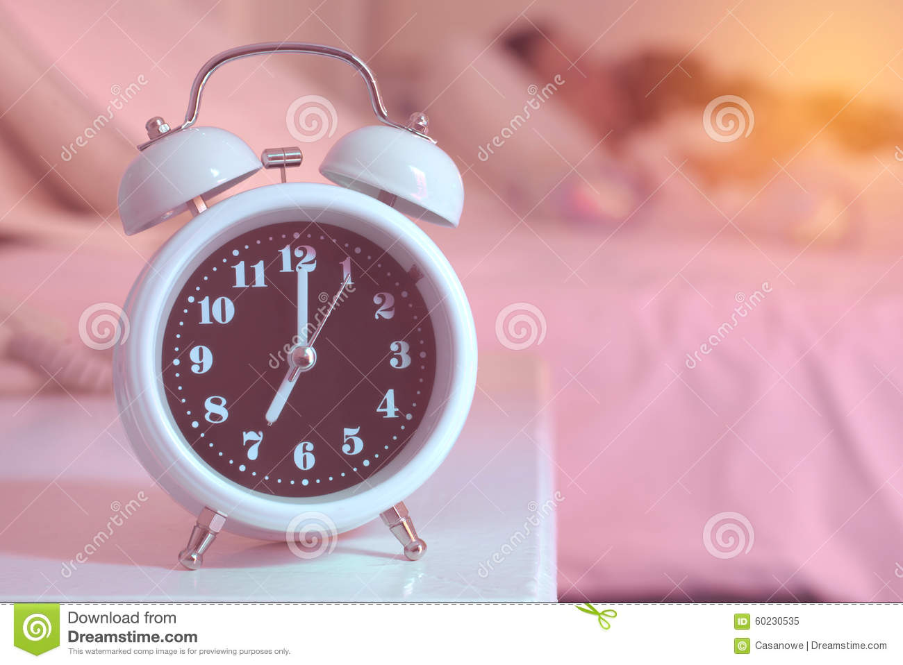 Alarm Clock On The Bed In Bedroom Stock Photo