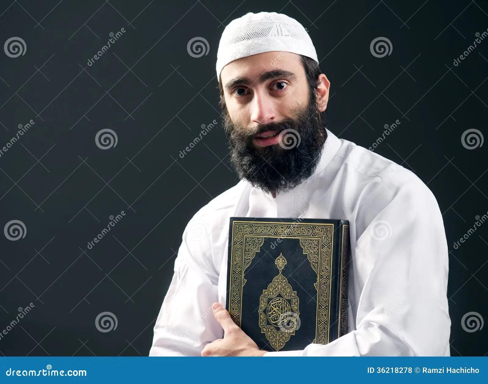 Arabian Muslim Man With Beard Holding The Holy Book Quran
