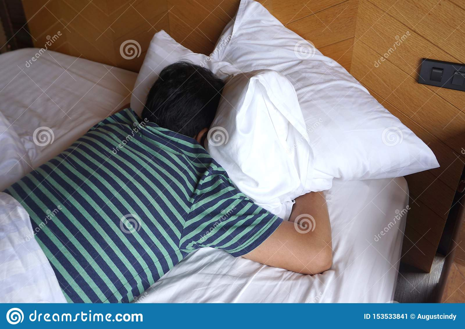 https www dreamstime com asian man wearing stripe t shirt sleeping white bed his face down bedroom image153533841