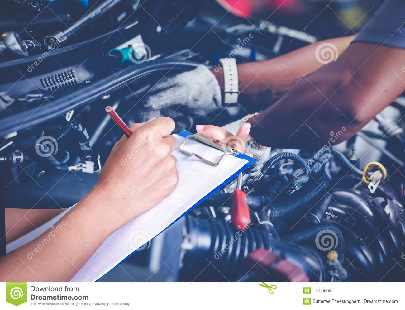 Male Mechanic Checking Oil In Car Workshop Royalty Free