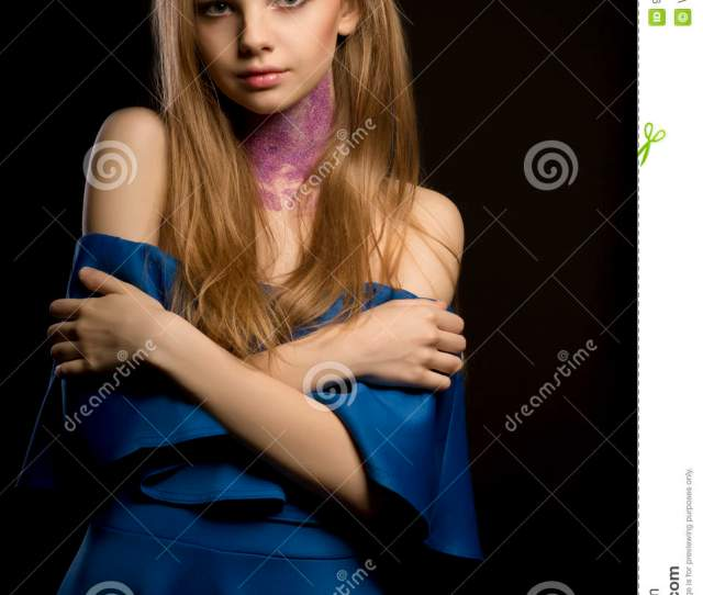 Attractive Blonde Woman With Creative Makeup And Dress With Naked Shoulders