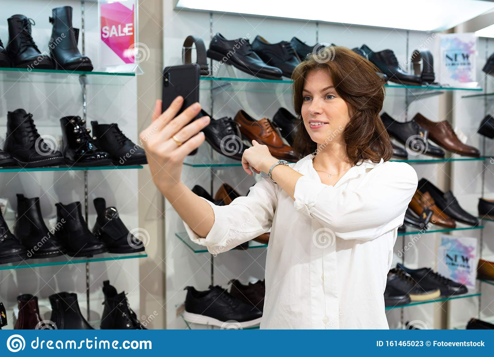 Attractive Caucasian Woman Points Out To Leather Shoes
