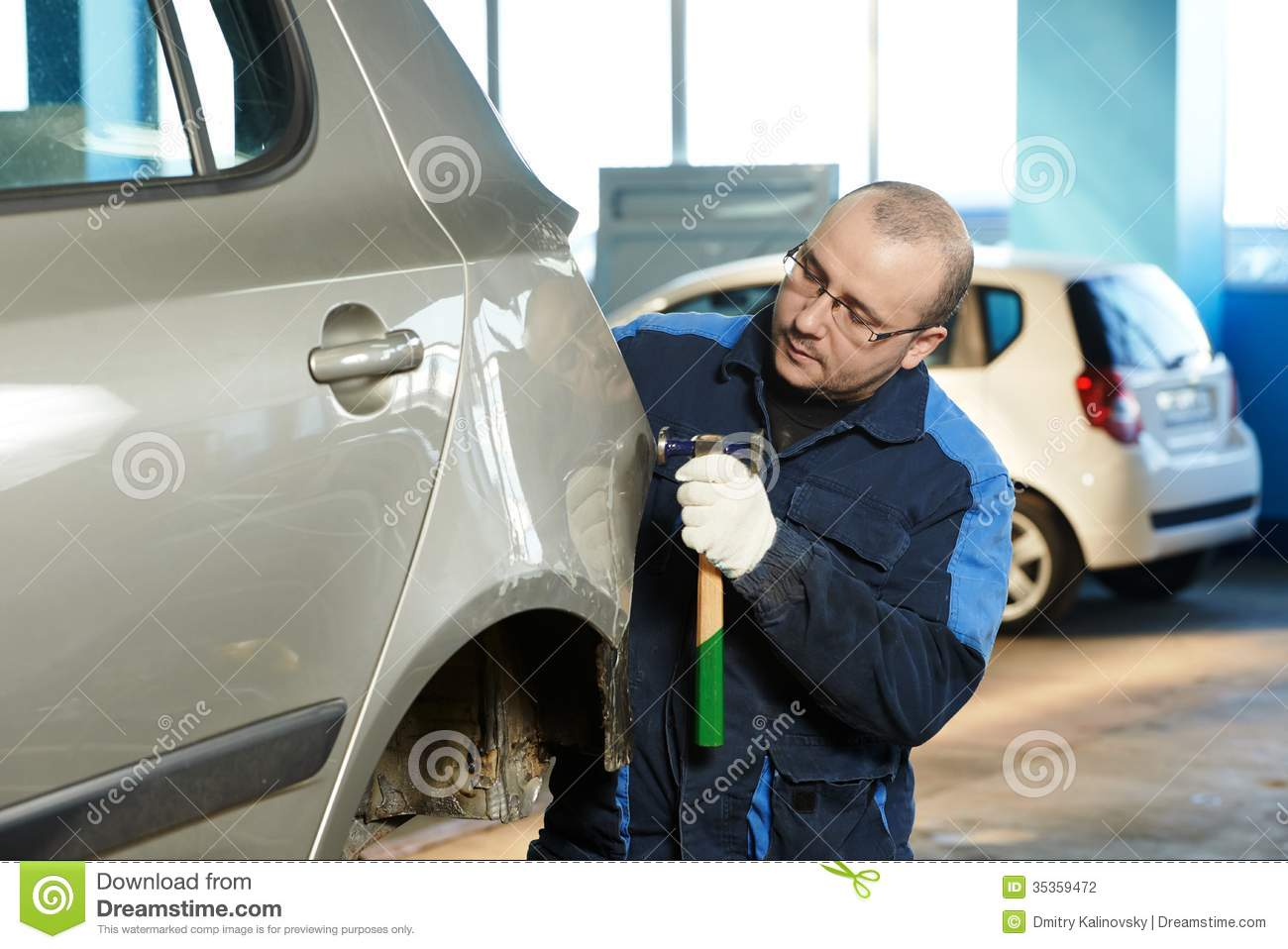 Auto Repair Man Flatten Metal Body Car Stock Photography