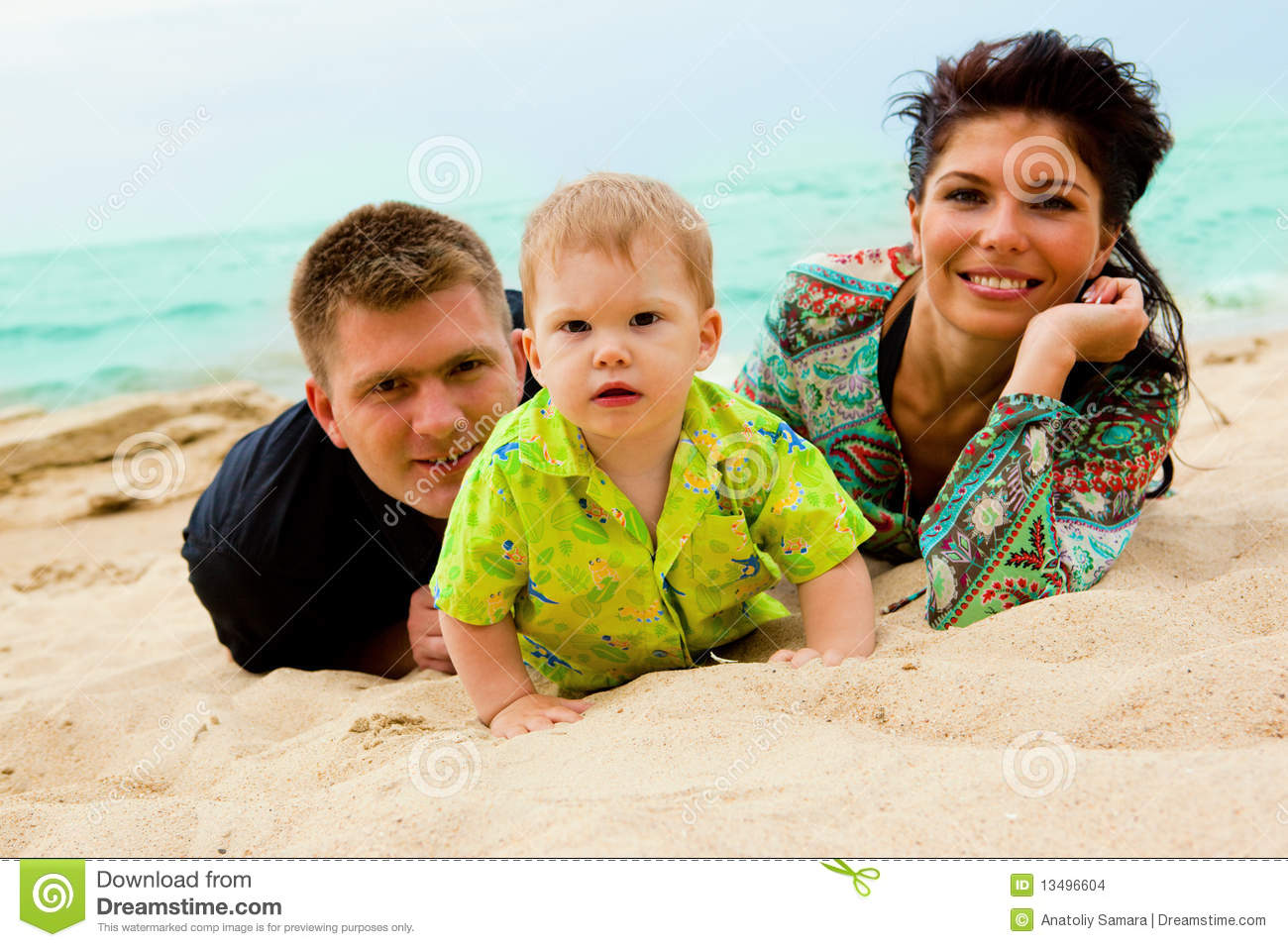 Baby Mom And Dad On Sand Stock Images
