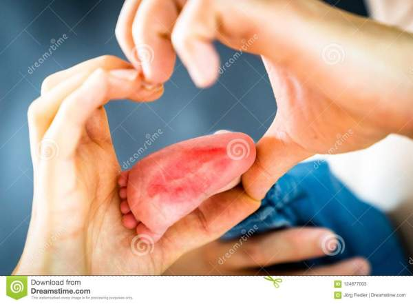 The baby`s foot with kiss stock image. Image of foot ...