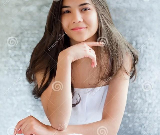 Beautiful Biracial Teen Girl In White Dress Sitting Thinking