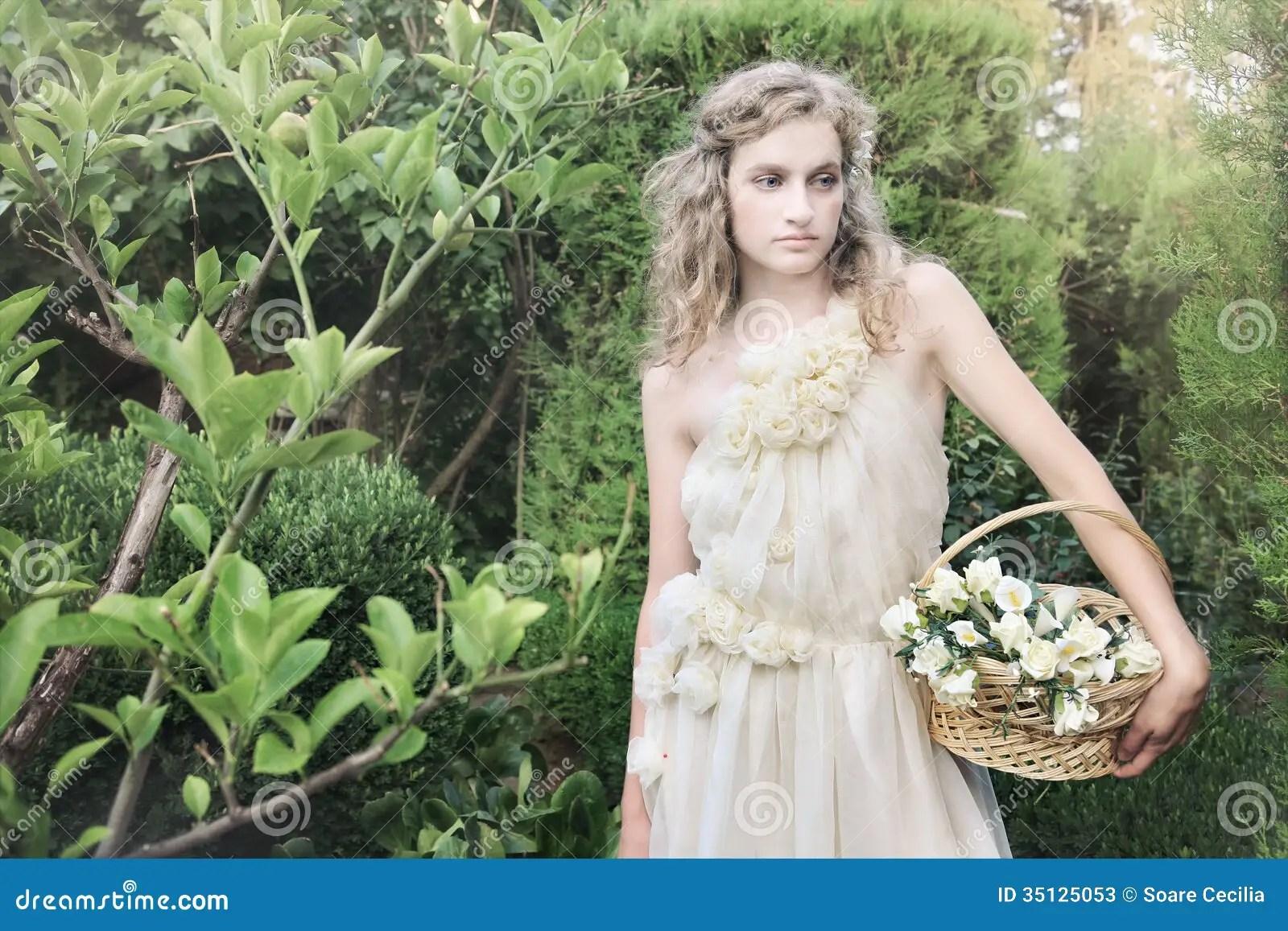 Beautiful Bride In Garden In Wedding Gown, Dress Stock