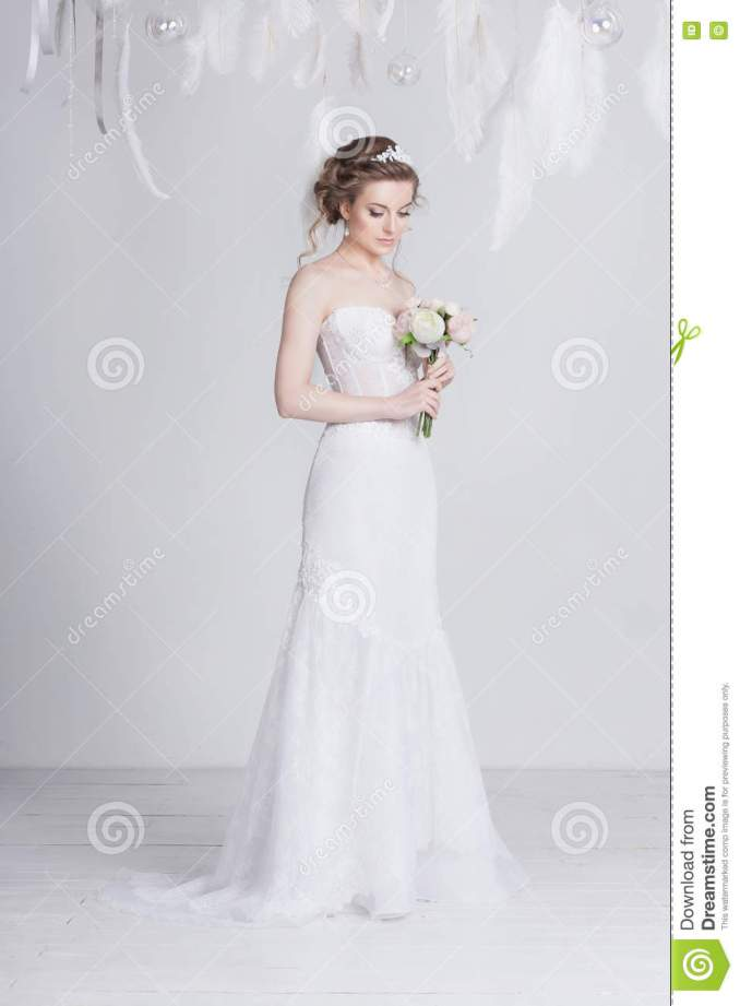 beautiful bride with lace flowers in her gorgeous dark blond