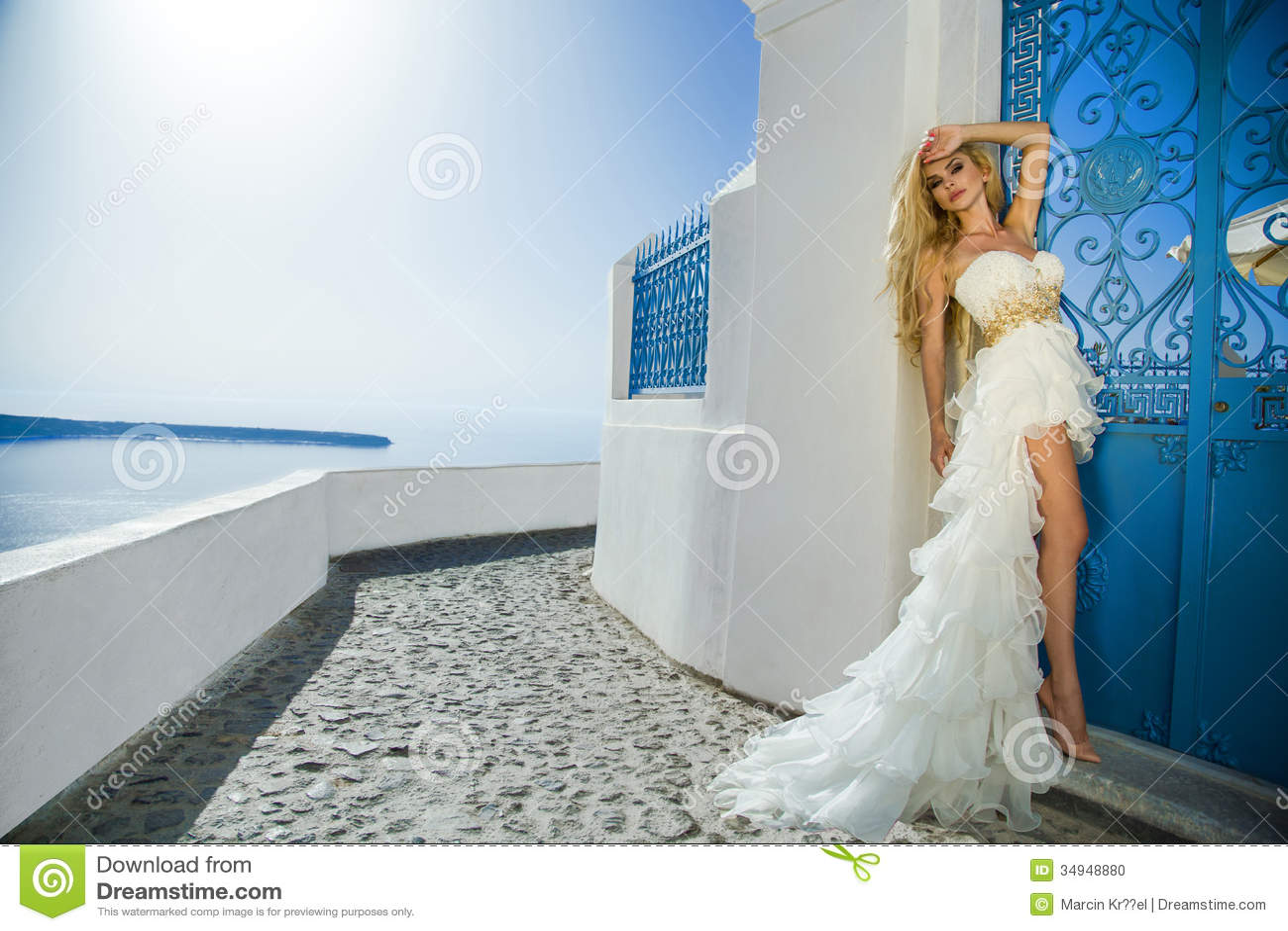 The Beautiful Bride In A Wedding Dress On Santorini In