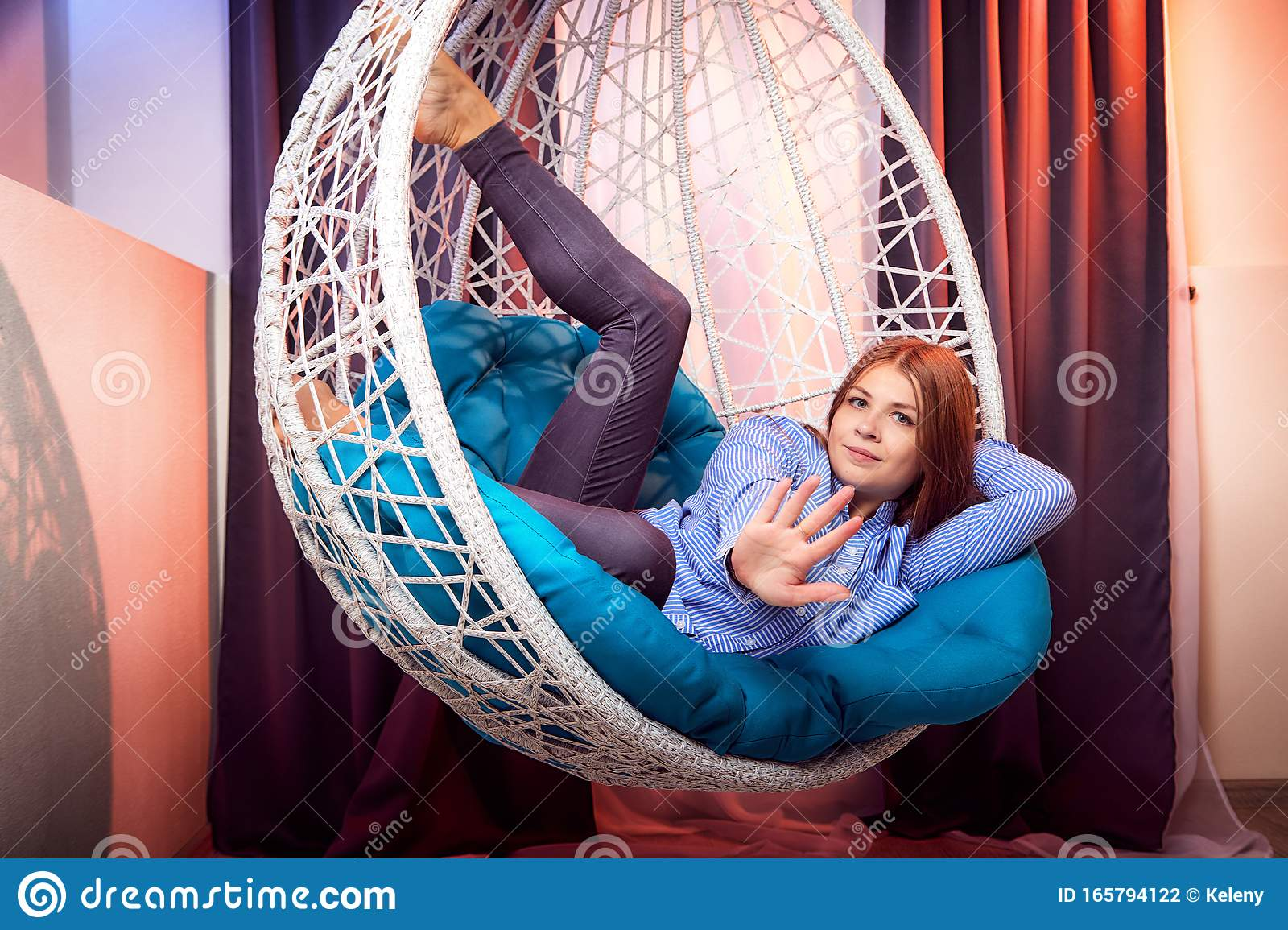 https www dreamstime com beautiful brunette girl blue shirt white wicker hanging chair pillow room curtains model posing photoshoot image165794122