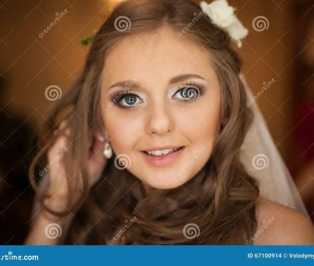 Beautiful Gorgeous Brunette Bride Putting On Luxury Earrings In