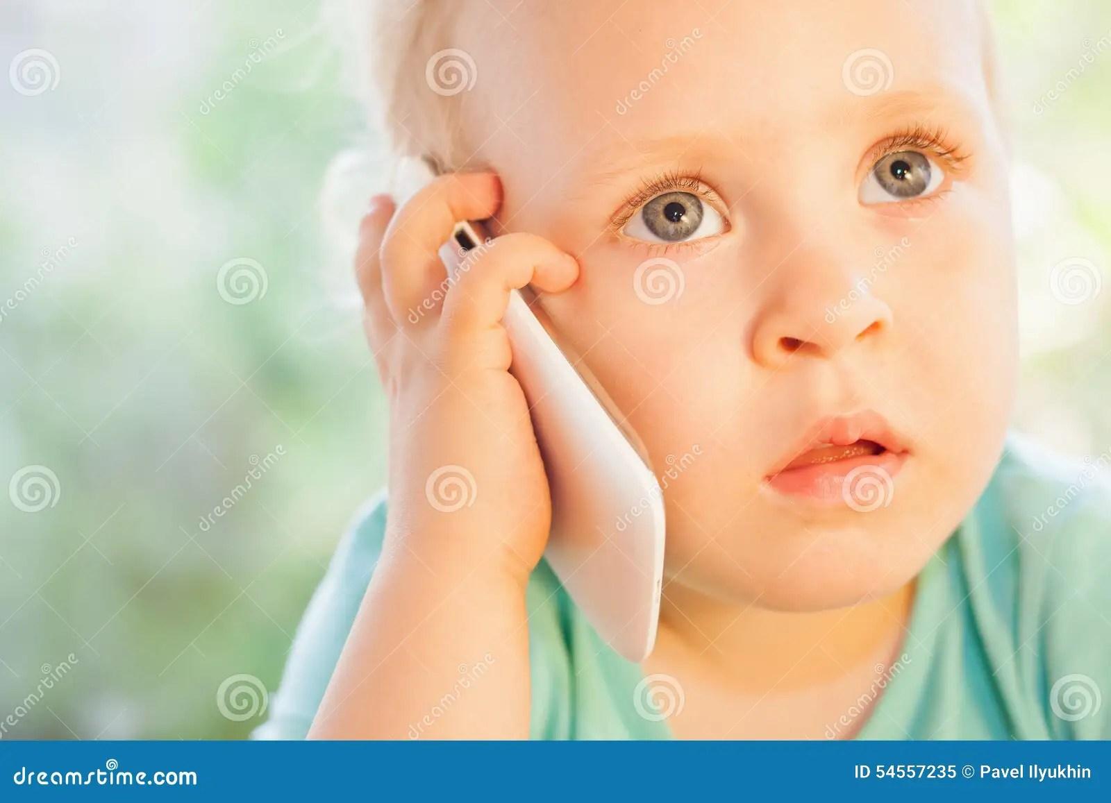 Portrait Of Little Caucasian Girl Talking On Mobile Phone