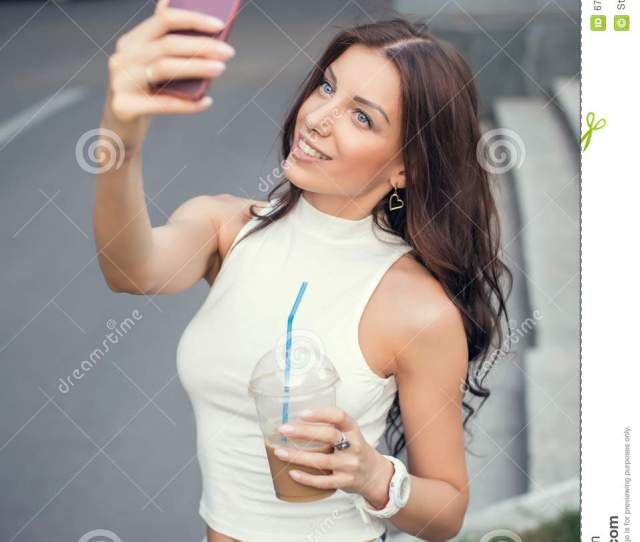 Beautiful Girl Taking A Selfie In The Street