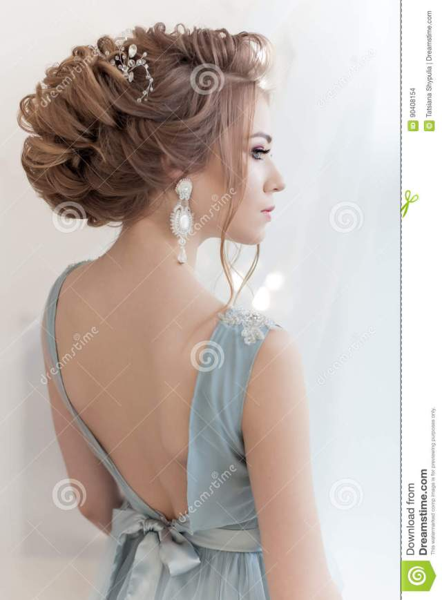 beautiful volume hairstyle for a bride in a gentle blue