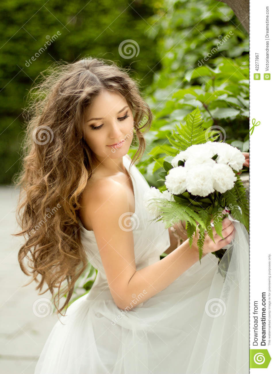Beautiful Young Bride With Long Wavy Hair And Wedding