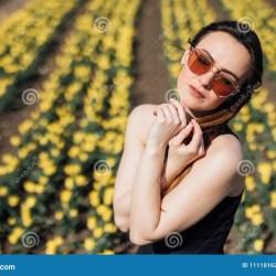 e9949a3df64b Beauty Young Woman In Sunglasses In Black Dress In Tulips Field