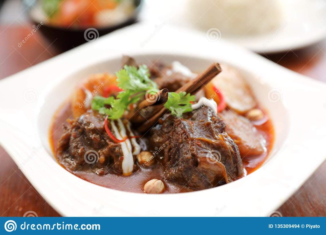 Beef Massaman Curry With Rice And Salad On Wooden Table ...