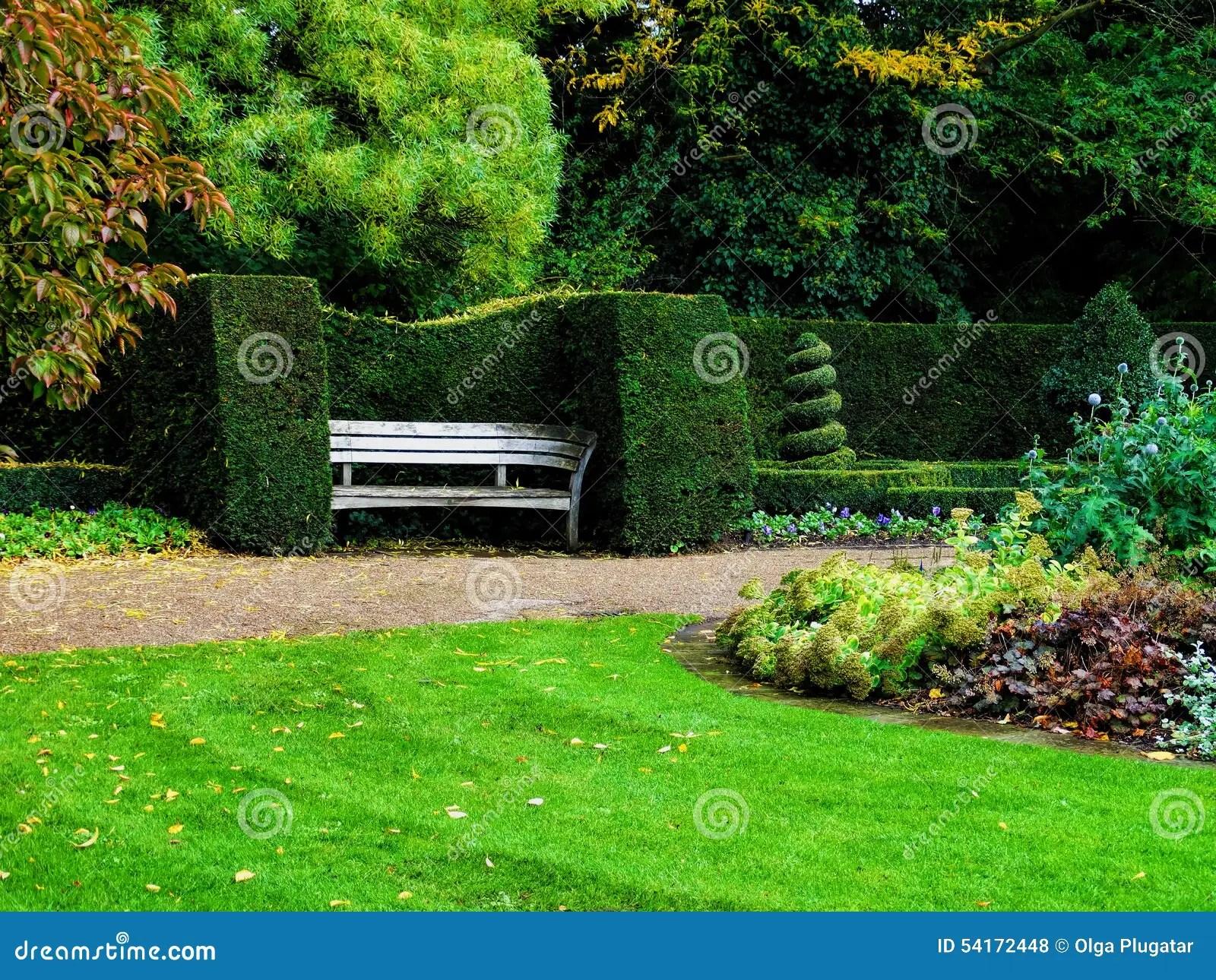 Bench In Nicely Trimmed Bushes In Regents Park London
